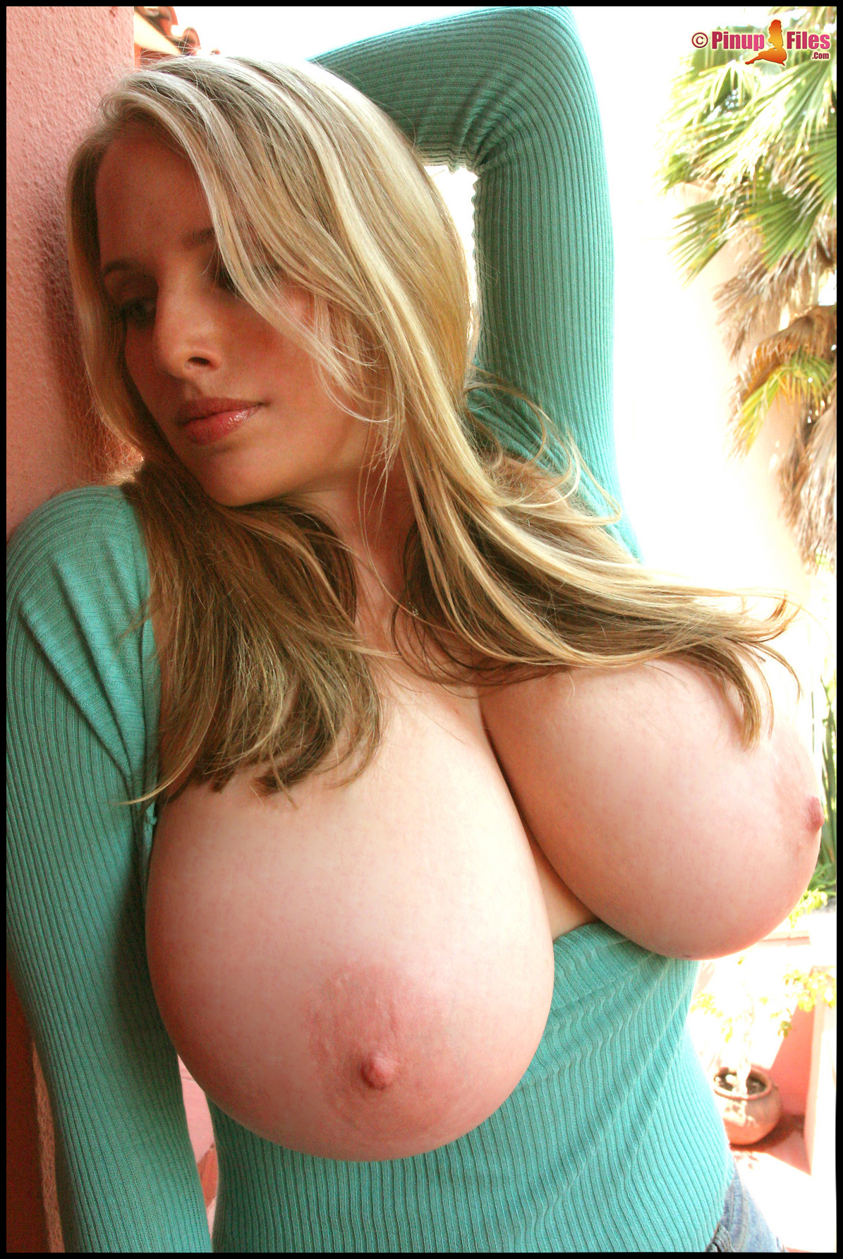 green sweater big boobs