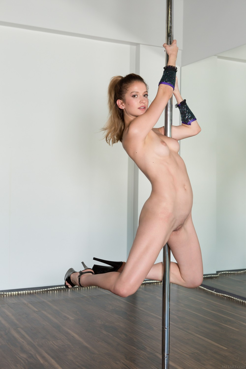 Naked pole danceing