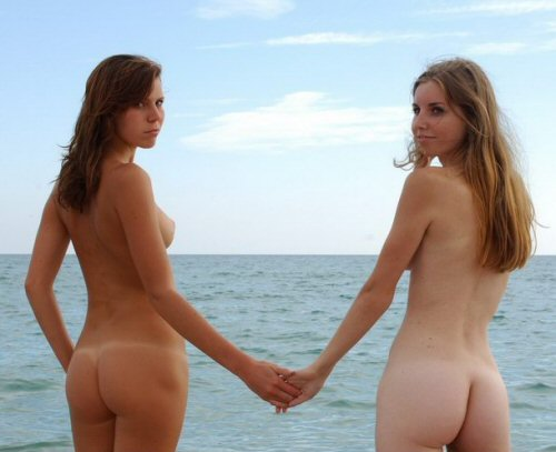 two girls naked on beach
