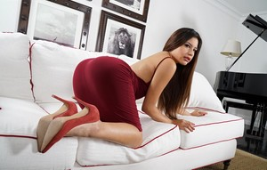 Zaya Cassidy relaxes on couch