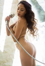 Alexis Love in transparent shower cabin