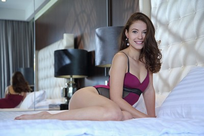 Jenna Kseniya undressing on bed, 16 photos