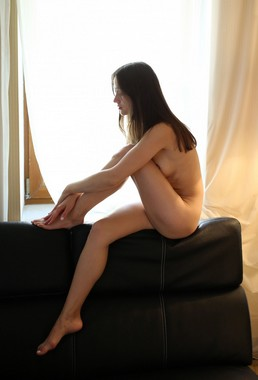 Naked Anna F Tatielle spreads her legs on bed